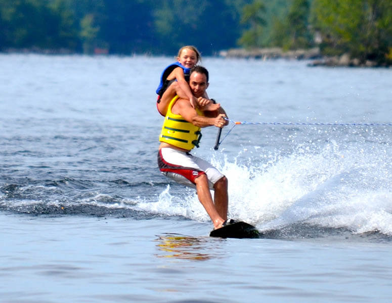Wohelo family waterskier with child on shoulders